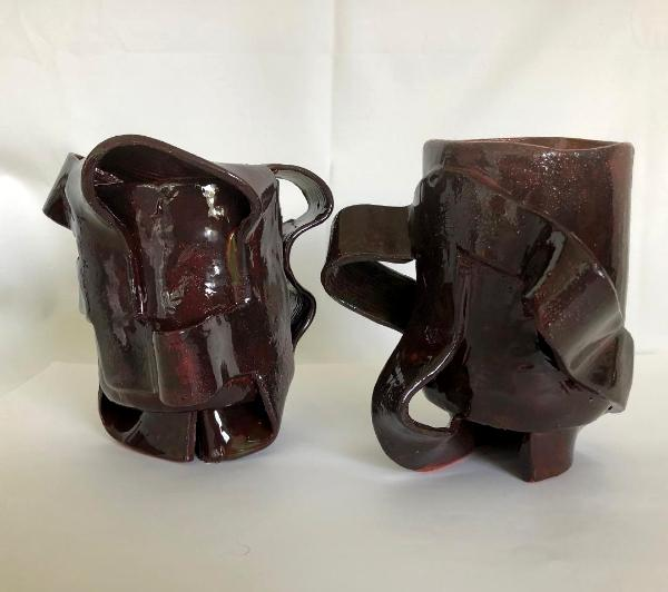 two brown ceramic mugs